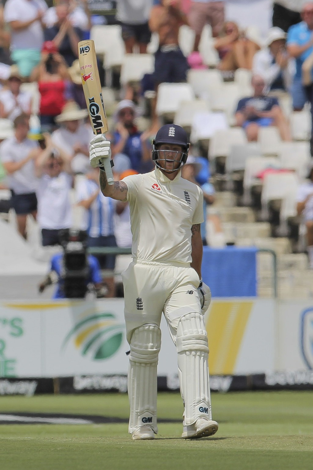 England's batsman Ben Stokes celebrates his fifty during day four of the second cricket test between South Africa and England at the Newlands Cricket ...