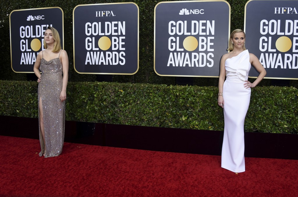 Saoirse Ronan, left, and Reese Witherspoon arrive at the 77th annual Golden Globe Awards at the Beverly Hilton Hotel on Sunday, Jan. 5, 2020, in Bever...