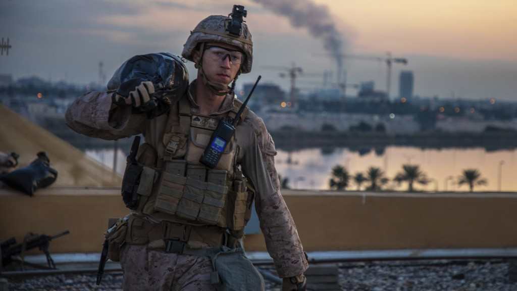 In this Saturday, Jan. 4, 2020, photo, released by the U.S. military, a U.S. Marine with 2nd Battalion, 7th Marines that is part of a quick reaction f...