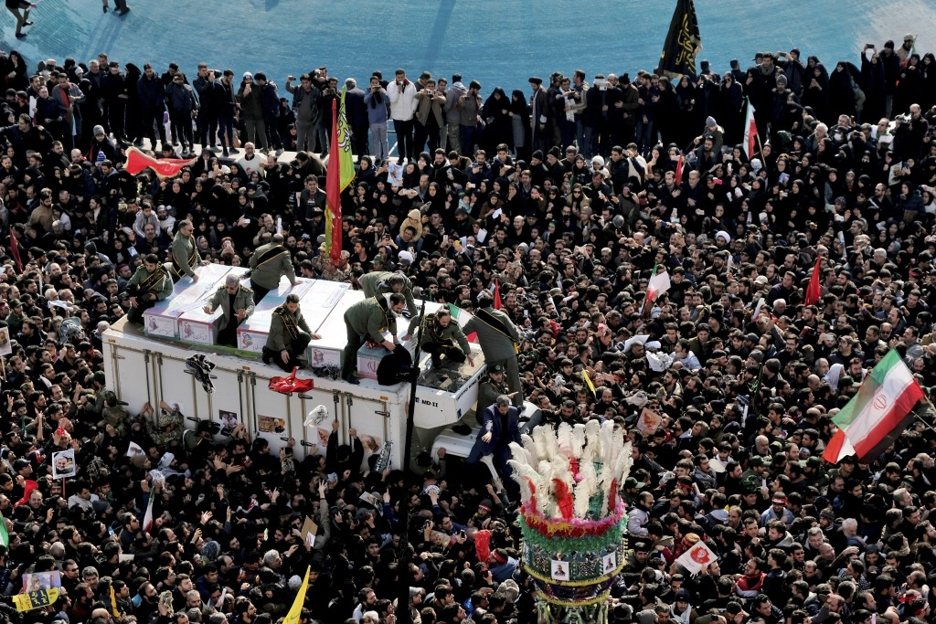 Coffins of Gen. Qassem Soleimani and others who were killed in Iraq by a U.S. drone strike, are carried on a truck surrounded by mourners during a fun...