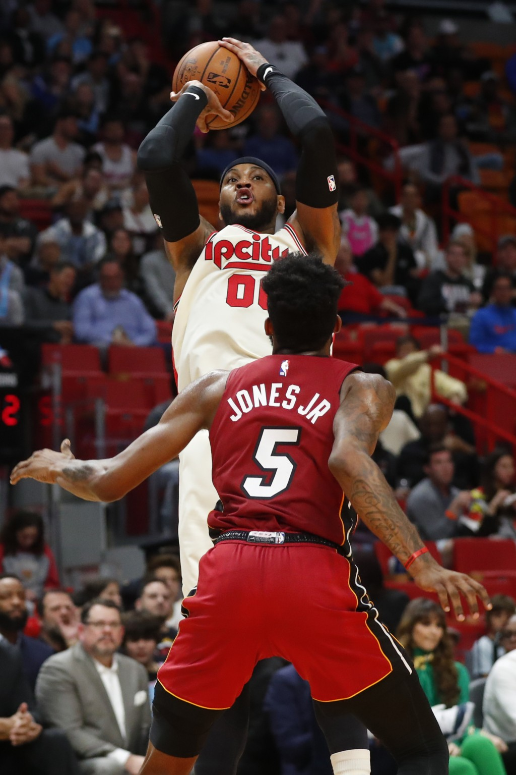 Portland Trail Blazers forward Carmelo Anthony (00) goes up to shoot against Miami Heat forward Derrick Jones Jr. (5) during the first half of an NBA ...