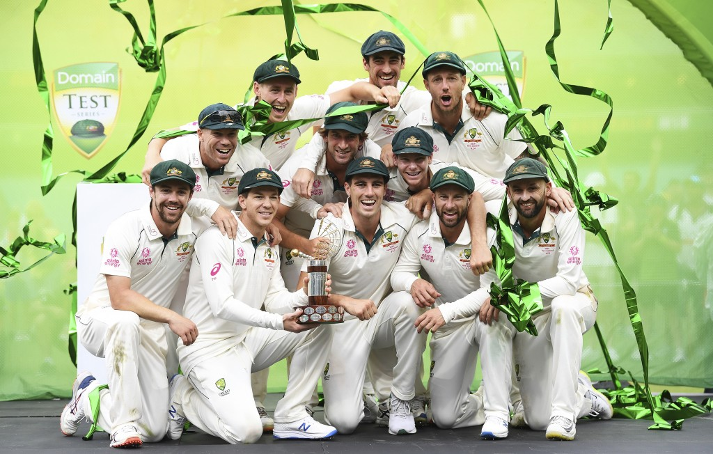 Australian players pose for a team photo as they celebrate winning the test match and series on day four of the third cricket test match between Austr...