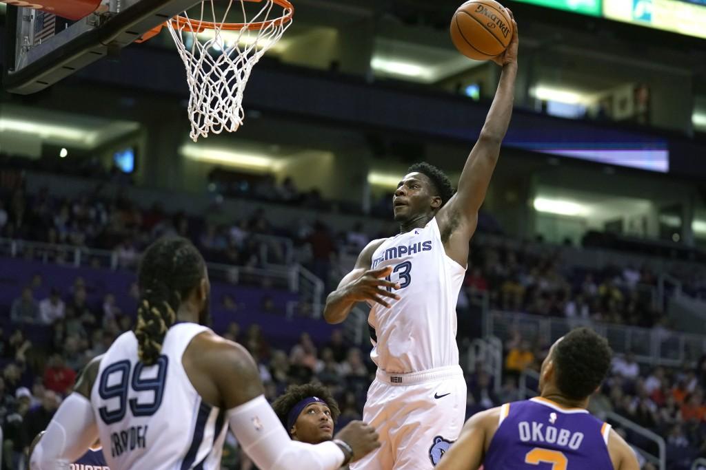 Memphis Grizzlies forward Jaren Jackson Jr. (13) dunks against the Phoenix Suns in the first half during an NBA basketball game, Sunday, Jan. 5, 2020,...