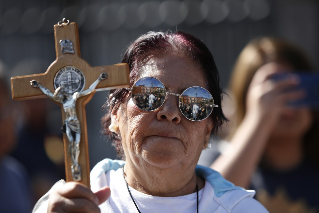 Silvia Sanchez Ordonez, 75, stands with a cross to protest against a group of women who were in a performance in favor of abortion rights next to the ...