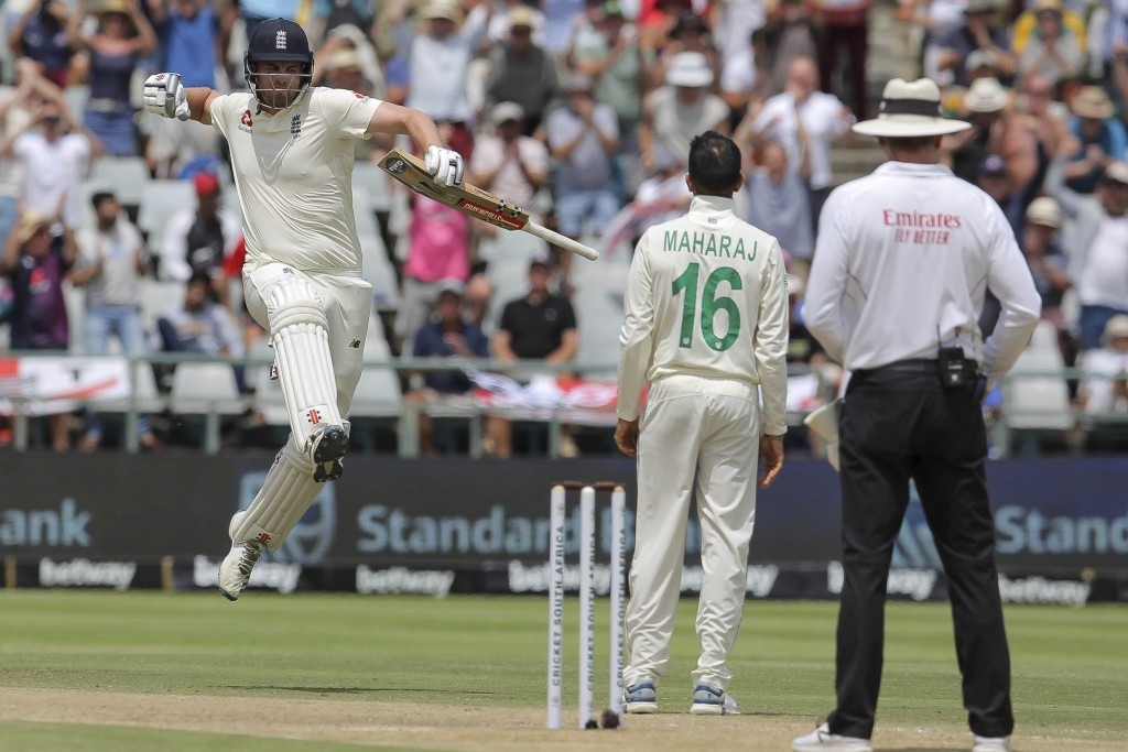 England's batsman Dom Sibley celebrates scoring one hundred during day four of the second cricket test between South Africa and England at the Newland...