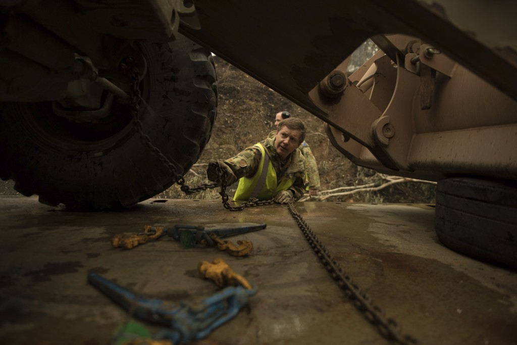 In this image released by the Department of Defense, dated Jan. 6, 2020, plant operator Cpl. Duncan Keith of the 22nd Engineer Regiment unloads a 434 ...