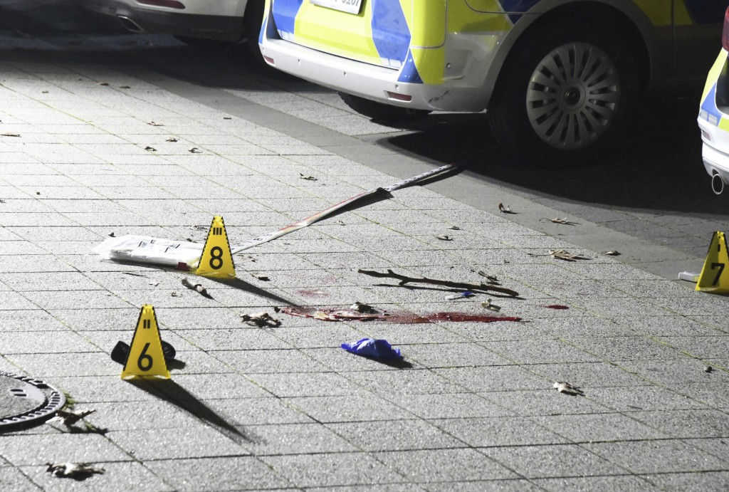 Markers placed on the ground inside cordoned-off area in front of a police station in Gelsenkirchen, Germany, late Sunday, Jan. 5, 20120. A 23-year-ol...