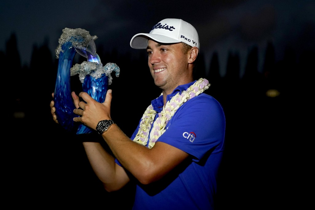 Justin Thomas holds the champions trophy after winning Tournament of Champions golf event, Sunday, Jan. 5, 2020, at Kapalua Plantation Course in Kapal...