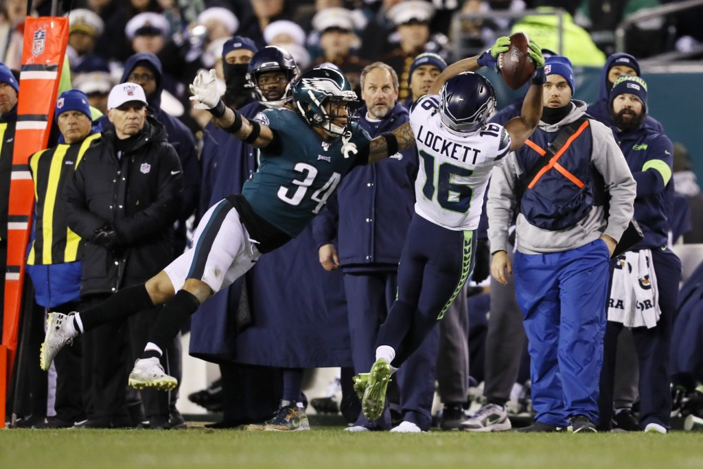 Seattle Seahawks' Tyler Lockett (16) catches a pass against Philadelphia Eagles' Cre'von LeBlanc (34) during the first half of an NFL wild-card playof...