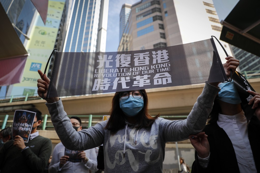 Pro-democracy demonstrators hold banners and placards during a rally at Causeway Bay in Hong Kong, Monday, Jan. 6, 2020. As Hong Kong enters its eight...