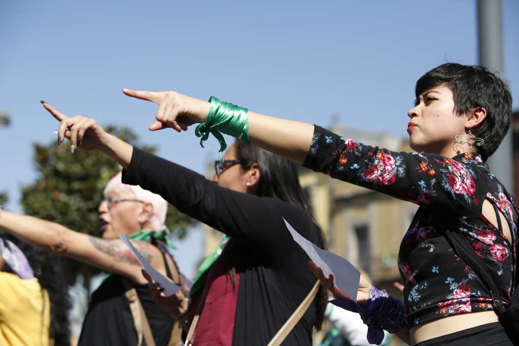 Midalia Soto, 26, right, participated in a pro-choice performance next to the cathedral in Mexico City, Sunday, Jan. 5, 2020. Mexico's ruling party, M...