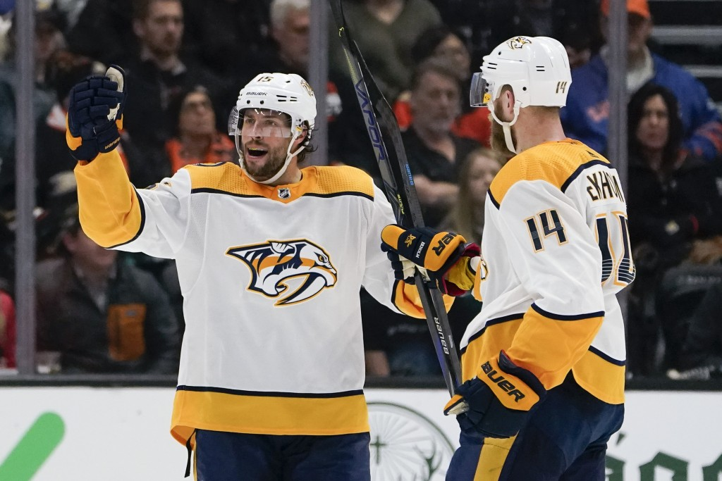 Nashville Predators right wing Craig Smith, left, celebrates after his goal with Mattias Ekholm during the second period of an NHL hockey game against...