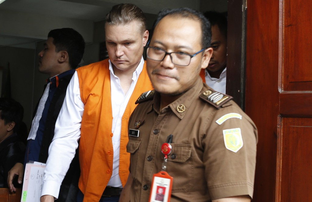 A police officer escorted convicted David van Iersel, center, after his court trial in Bali, Indonesia on Monday, Jan. 6, 2020. The judge has sentence...