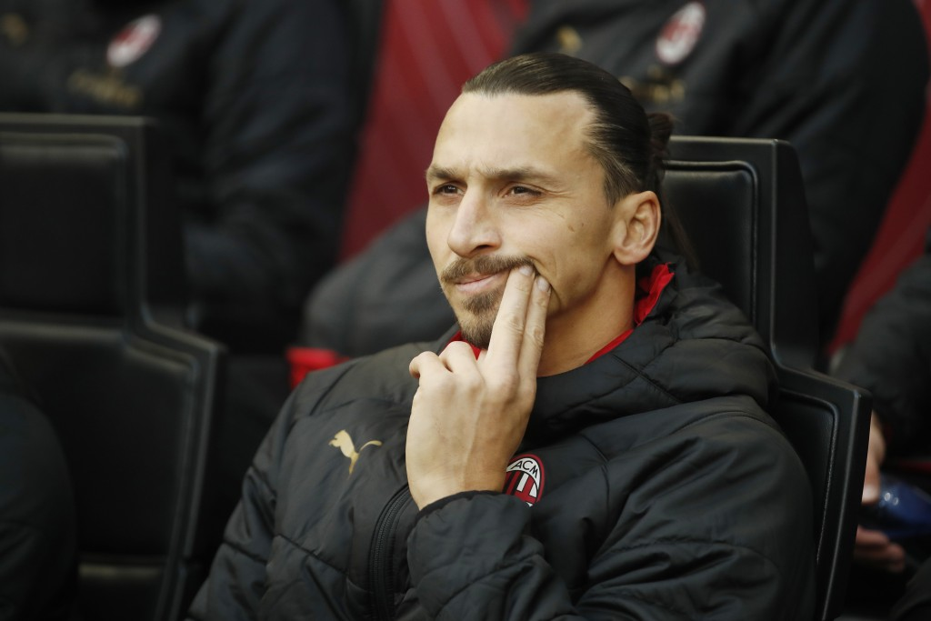 AC Milan's Zlatan Ibahimovic sits on the bench prior to the start of the Serie A soccer match between AC Milan and Sampdoria at the San Siro stadium, ...