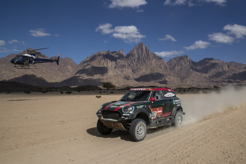 Driver Orlando Terranova, of Argentina, and co-driver Bernardo Graue, of Argentina, race their Mini during stage two of the Dakar Rally, between Al Wa...