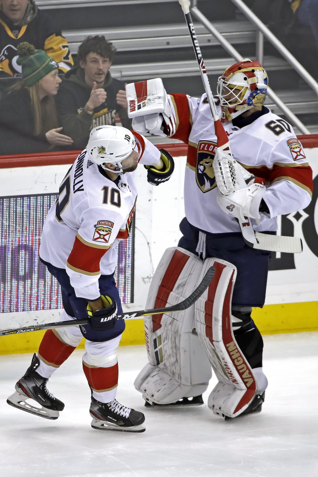 Florida Panthers' Brett Connolly (10) celebrates his goal with goaltender Chris Driedger (60) during the first period of an NHL hockey game against th...
