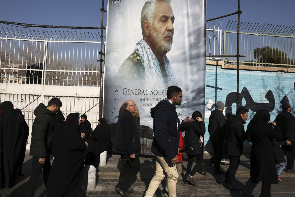 Mourners walk back from a funeral ceremony for Iranian Gen. Qassem Soleimani in front of the former U.S. Embassy, who was killed with others in Iraq b...