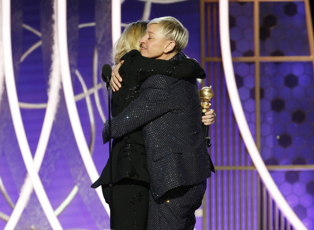 This image released by NBC shows presenter Kate McKinnon, left, embracing Ellen DeGeneres as she accepts the Carol Burnett TV Achievement Award at the...