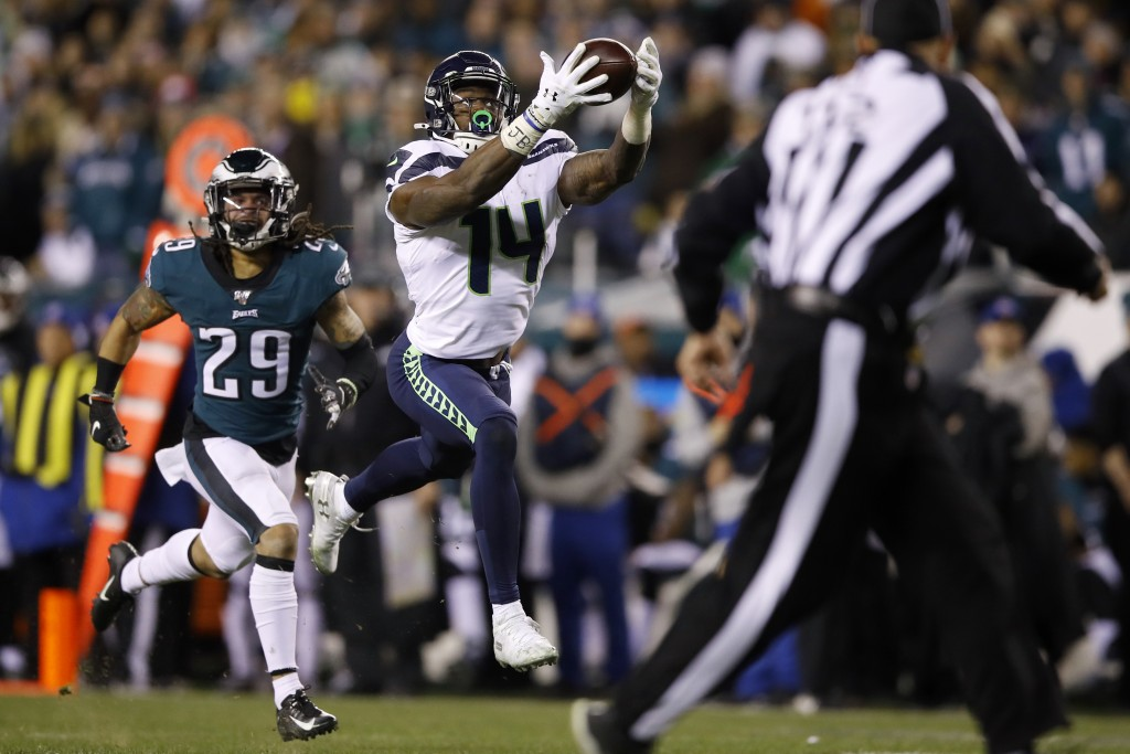 Seattle Seahawks' D.K. Metcalf (14) catches a touchdown pass as Philadelphia Eagles' Avonte Maddox (29) trails during the second half of an NFL wild-c...