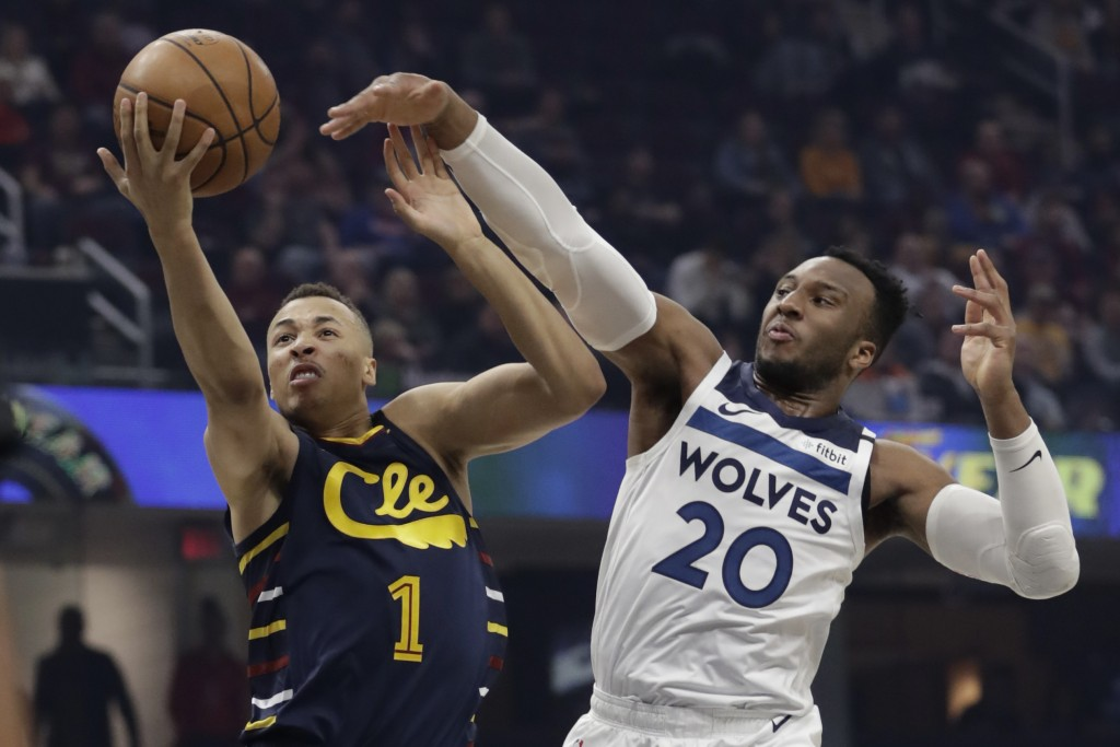 Cleveland Cavaliers' Dante Exum (1) drives to the basket against Minnesota Timberwolves' Josh Okogie (20) in the first half of an NBA basketball game,...