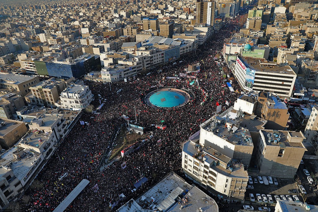 In this aerial photo released by an official website of the office of the Iranian supreme leader, mourners attend a funeral ceremony for Iranian Gen. ...