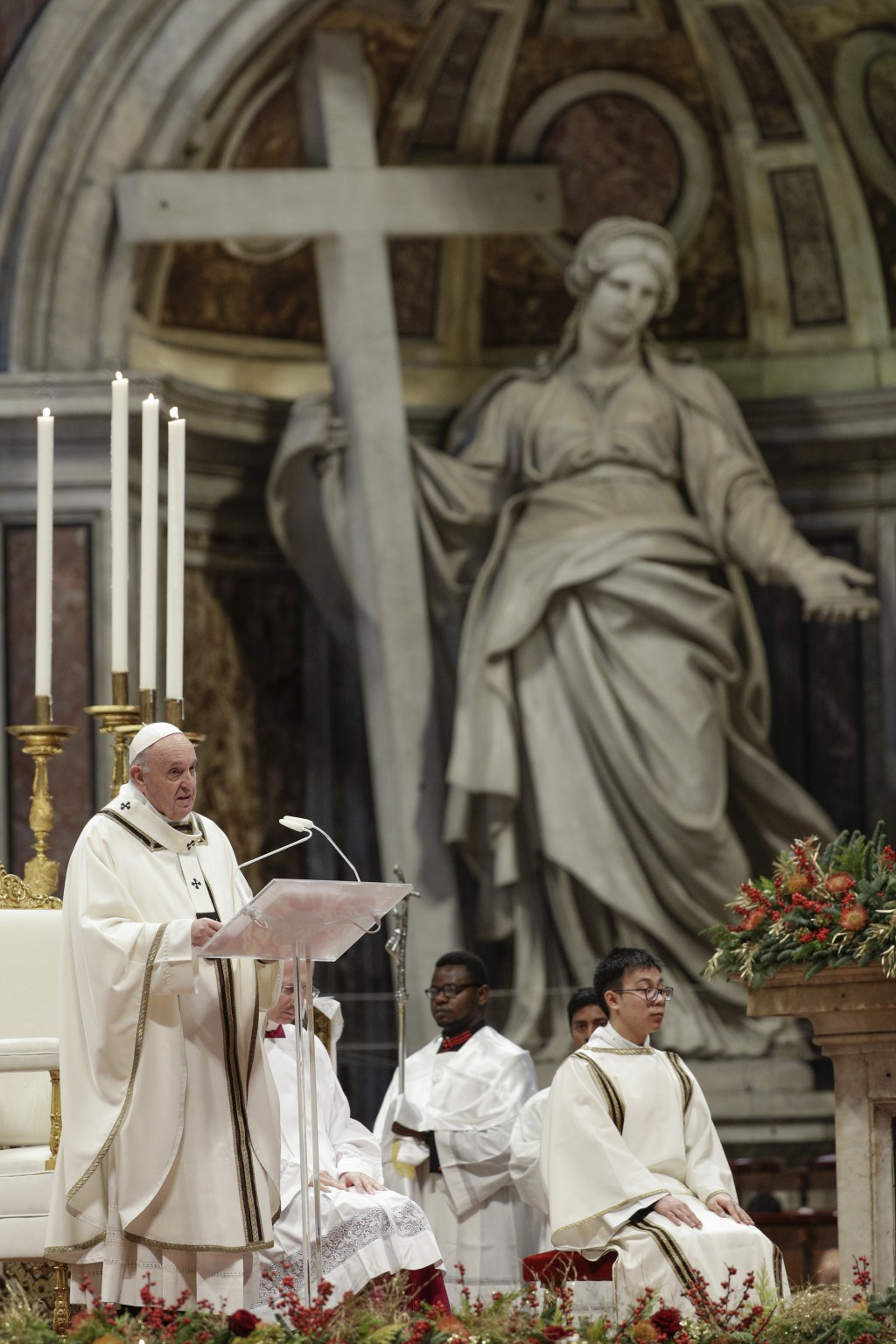 Pope Francis delivers his speech as he celebrates an Epiphany Mass in St. Peter's Basilica at the Vatican, Monday, Jan. 6, 2020. (AP Photo/Andrew Medi...