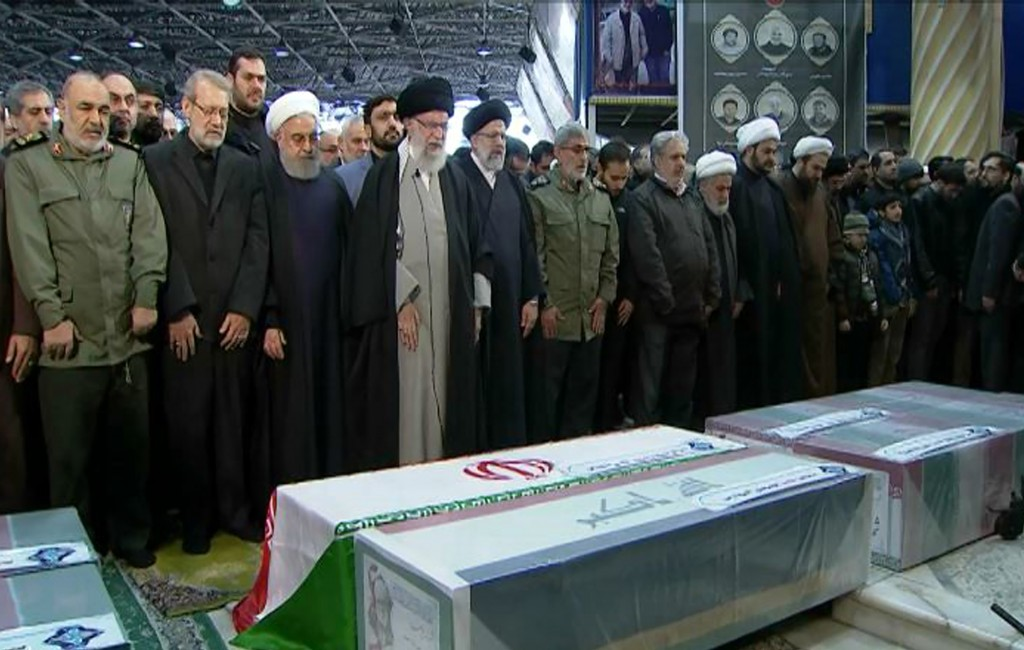 FILE- In this photo released by the official website of the Office of the Iranian Supreme Leader, supreme leader Ayatollah Ali Khamenei, front row, fo...