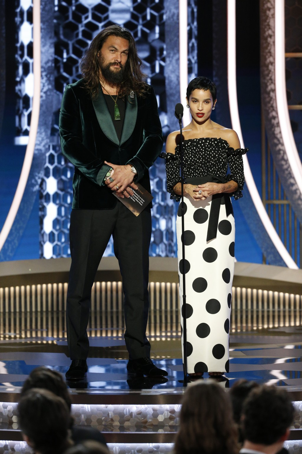 This image released by NBC shows presenters Jason Momoa, left, and Zoe Kravitz at the 77th Annual Golden Globe Awards at the Beverly Hilton Hotel in B...