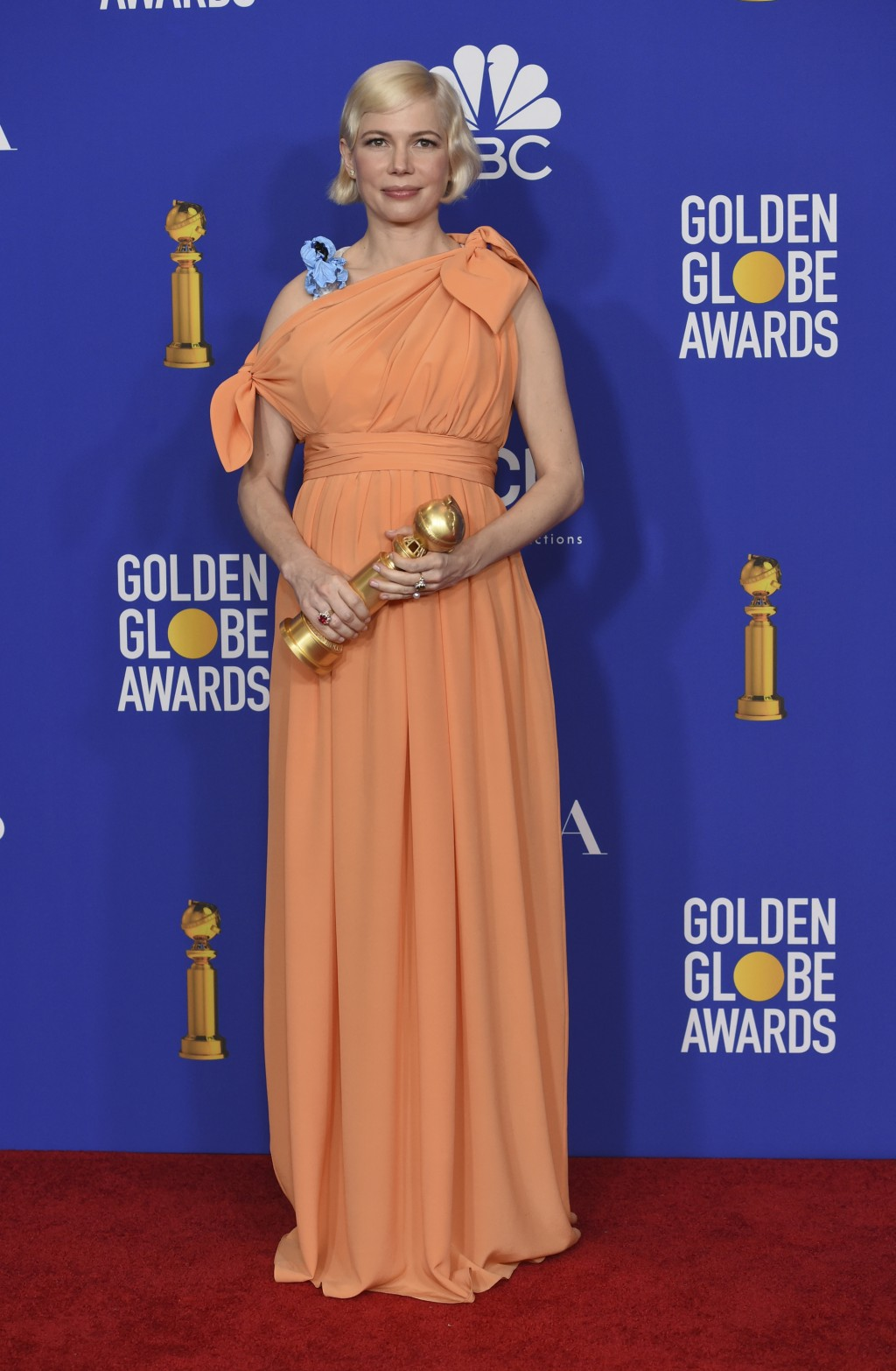 Michelle Williams poses in the press room with the award for best television performance by an actress in a limited series or a motion picture made fo...