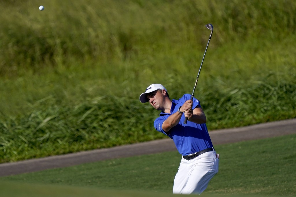 Justin Thomas chips onto the 12th green during final round of the Tournament of Champions golf event, Sunday, Jan. 5, 2020, at Kapalua Plantation Cour...