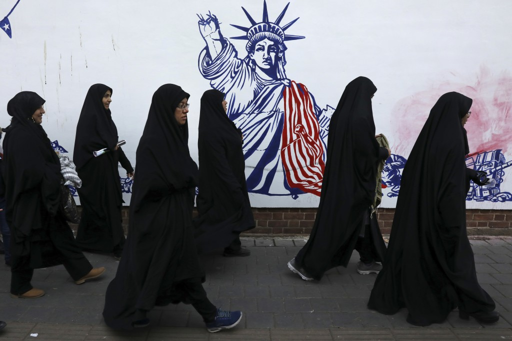 Mourners walk back from a funeral ceremony for Iranian Gen. Qassem Soleimani and his comrades, who were killed in Iraq in a U.S. drone attack on Frida...
