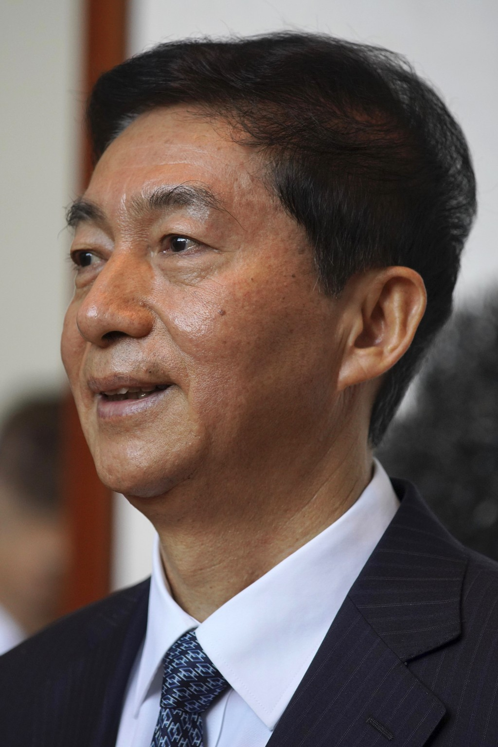 Newly appointed head of China's liaison office in Hong Kong, Luo Huining, speaks during a media briefing at the China's liaison office in Hong Kong, M...