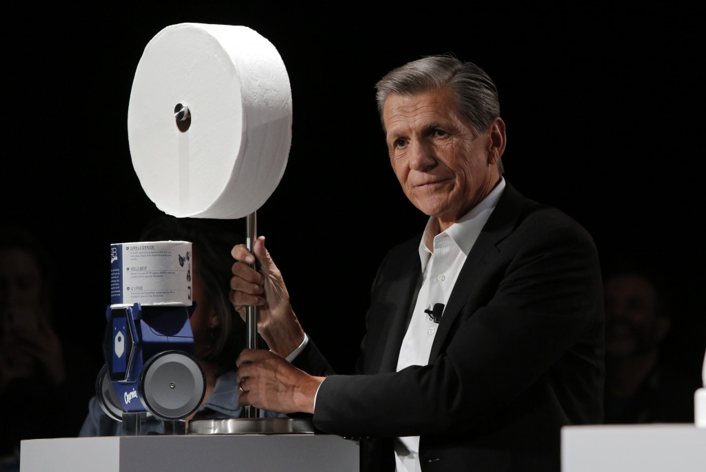 Procter & Gamble Chief Brand Officer Marc Pritchard shows off the Charmin Forever Roll and the Charmin RollBot during a Procter & Gamble news conferen...