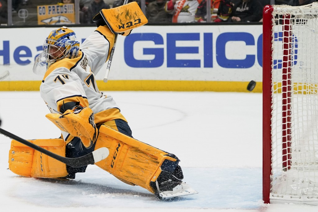 Nashville Predators goaltender Juuse Saros fails to block a goal by Anaheim Ducks right wing Daniel Sprong during the second period of an NHL hockey g...
