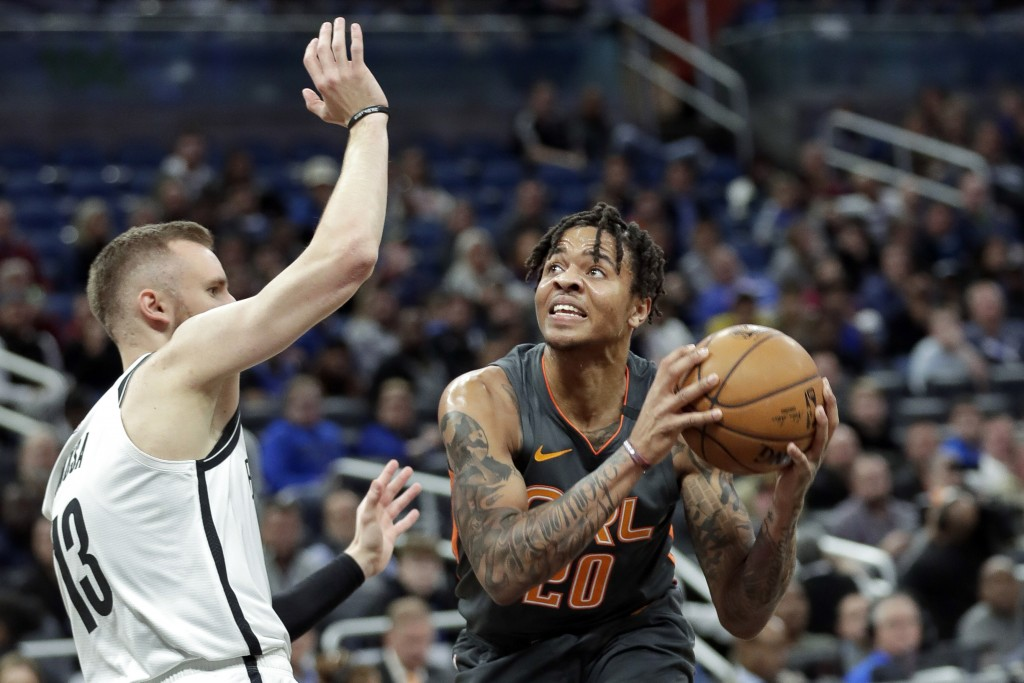 Orlando Magic guard Markelle Fultz, right, looks for a shot against Brooklyn Nets guard Dzanan Musa during the first half of an NBA basketball game, M...