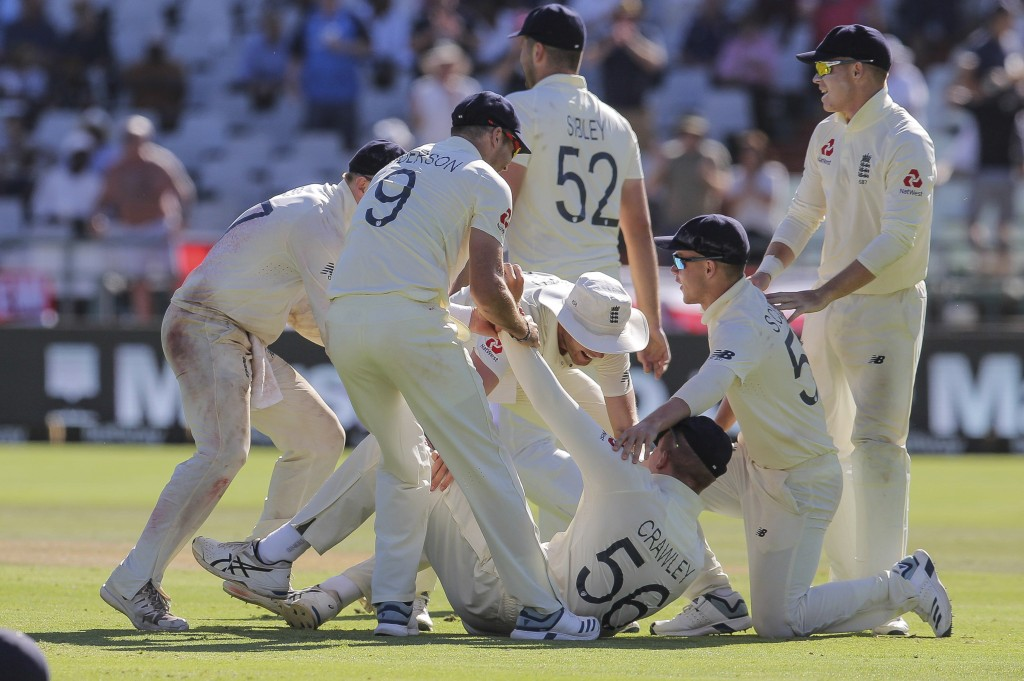 The England team celebrate the wicket of Anrich Nortje during day five of the second cricket test between South Africa and England at the Newlands Cri...