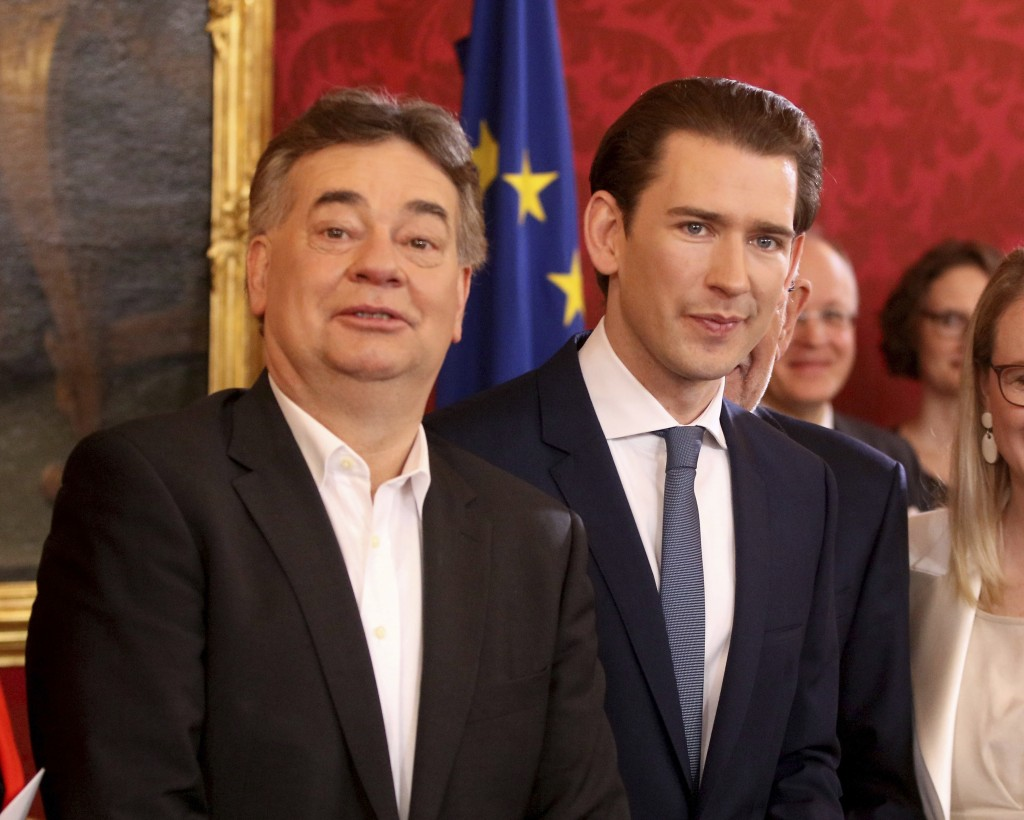 New Vice Chancellor Werner Kogler, left, and Chancellor Sebastian Kurz, right, attend the swearing-in ceremony of the new Austrian government of the c...