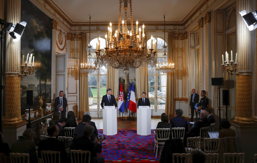 French President Emmanuel Macron, right, speaks a news conference with Croatian Prime Minister Andrej Plenkovic at the Elysee Palace in Paris, Tuesday...