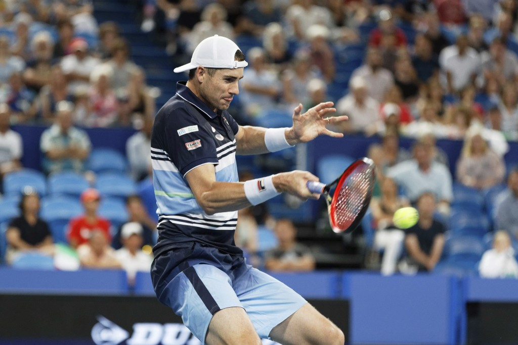 John Isner of the United States in action against Fabio Fognini of Italy during their match at the ATP Cup in Perth, Australia, Tuesday, Jan. 7, 2020....