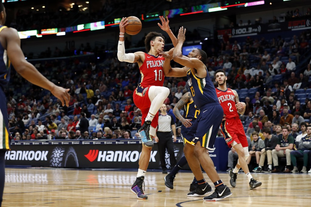 New Orleans Pelicans center Jaxson Hayes (10) is defended by Utah Jazz center Tony Bradley (13) in the first half of a NBA basketball game in New Orle...
