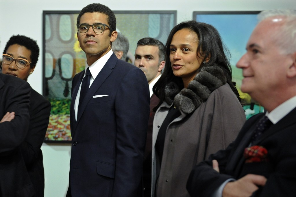 In this March 5, 2015 photo, Isabel dos Santos, reputedly Africa's richest woman, and her husband and art collector Sindika Dokolo, center left, atten...