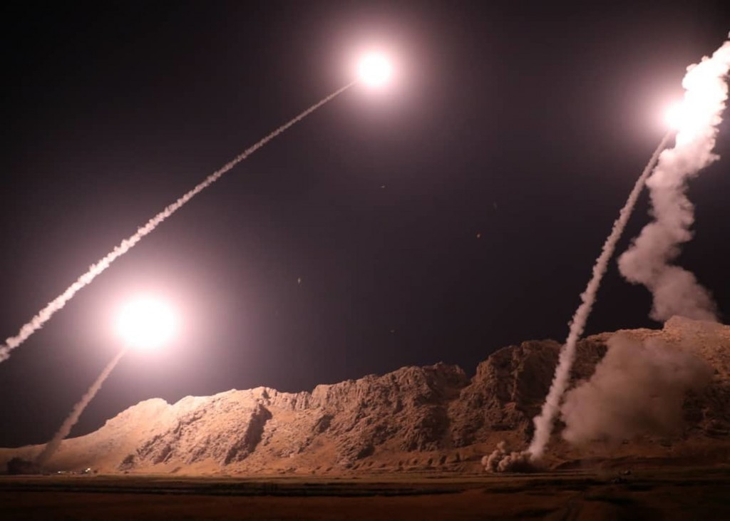 FILE - In this file photo released on Oct. 1, 2018, by the Iranian Revolutionary Guard, missiles are fired from city of Kermanshah in western Iran tar...