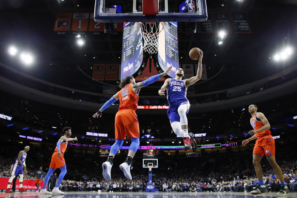 Philadelphia 76ers' Ben Simmons (25) goes up for a shot against Oklahoma City Thunder's Steven Adams (12) during the first half of an NBA basketball g...