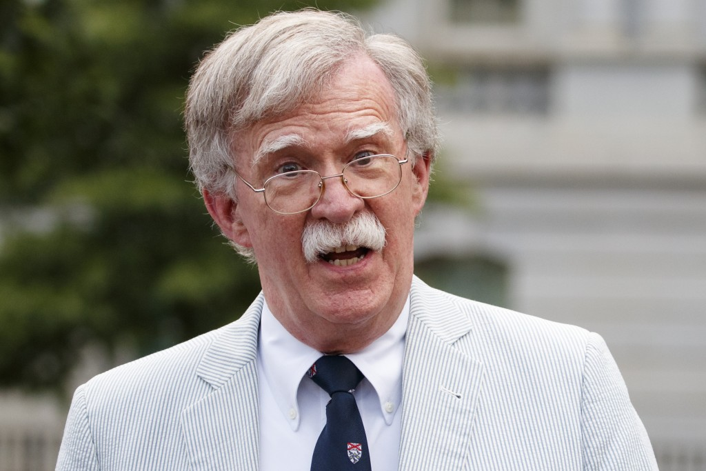 FILE - In this July 31, 2019 file photo, then National security adviser John Bolton speaks to media at the White House in Washington.  Bolton says he'...
