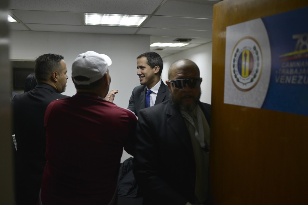 """Opposition leader Juan Guaido arrives at the political headquarters of """"Democratic Action"""" before going to the National Assembly in Caracas, Venezuela..."""