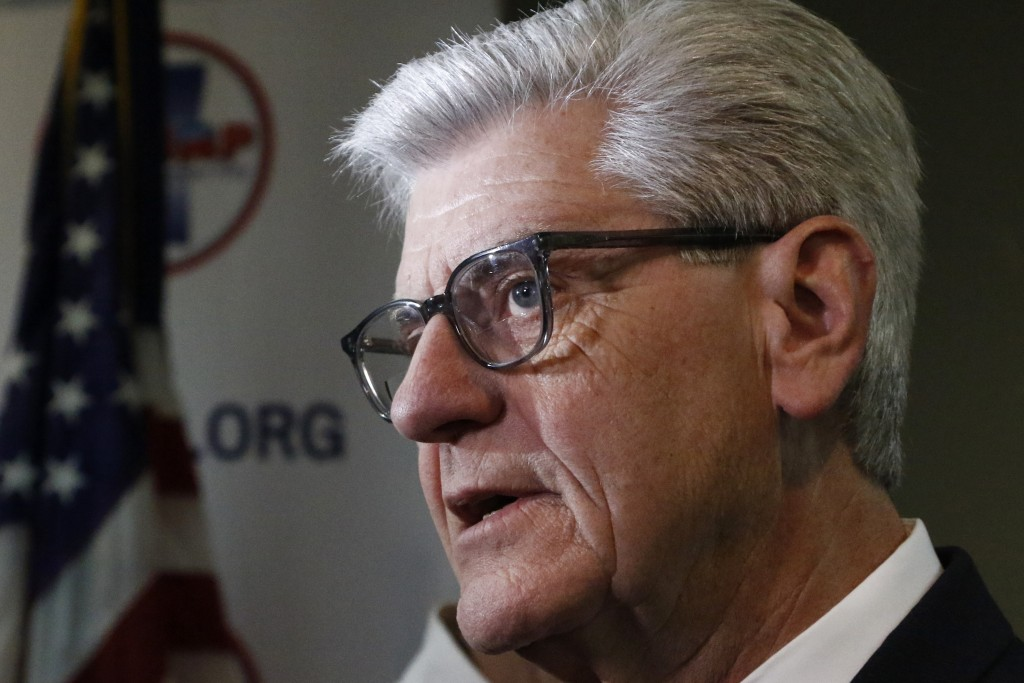 Gov. Phil Bryant discusses with reporters, his concerns about the recent violence at the state penitentiary in Parchman, Monday, Jan. 6, 2020, in Jack...