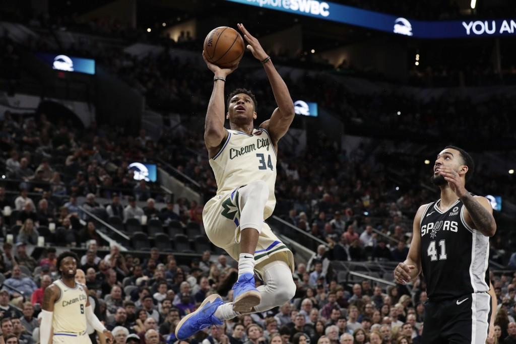 Milwaukee Bucks forward Giannis Antetokounmpo (34) shoots past San Antonio Spurs forward Trey Lyles (41) during the second half of an NBA basketball g...