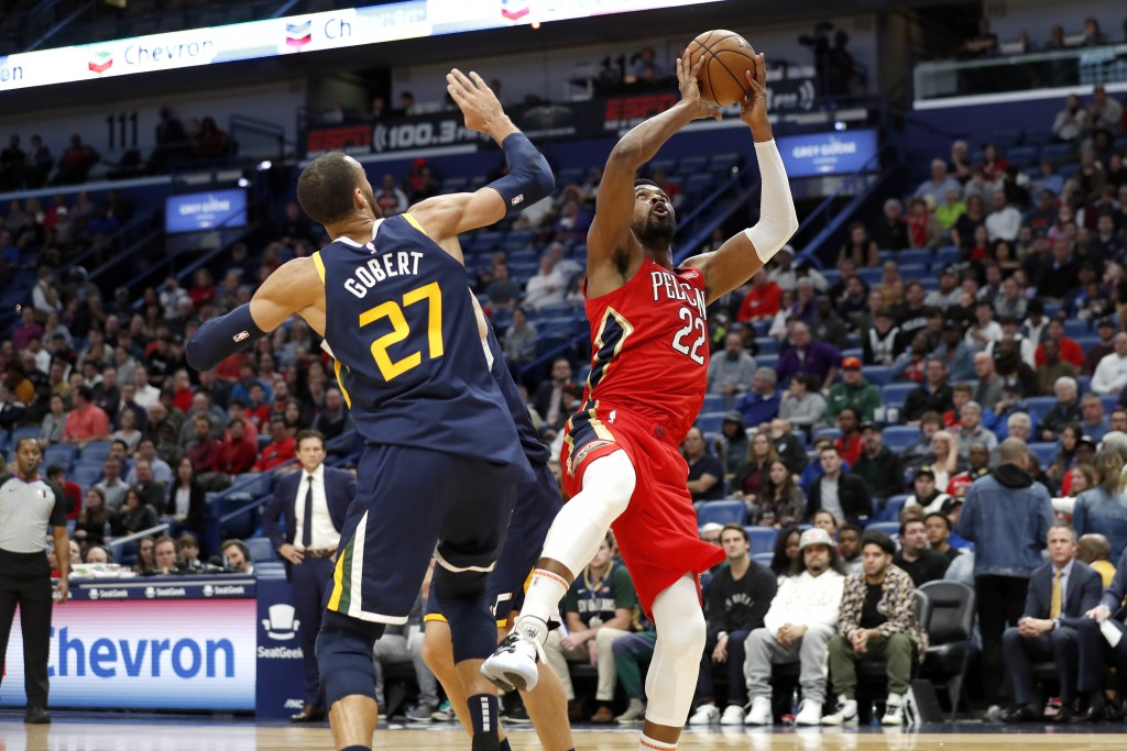 New Orleans Pelicans forward Derrick Favors (22) shoots over Utah Jazz center Rudy Gobert (27) in the first half of an NBA basketball game in New Orle...