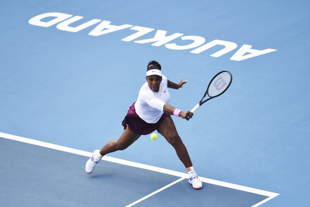 United States' Serena Williams makes a return during her match against Italy's Camila Giorgi at the ASB Classic in Auckland, New Zealand, Tuesday, Jan...