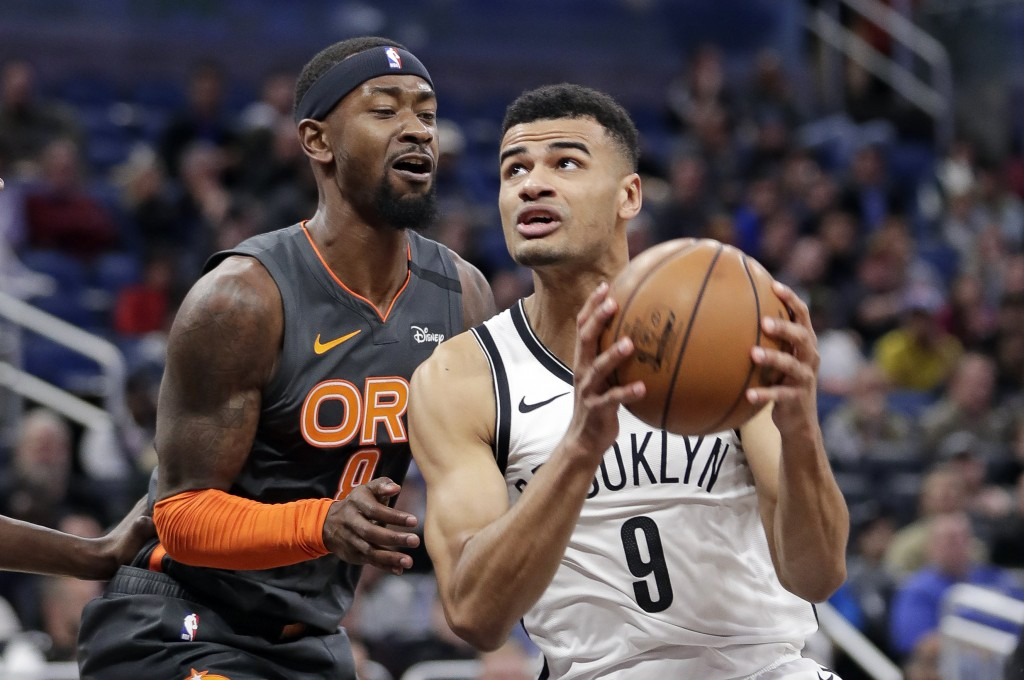 Brooklyn Nets guard Timothe Luwawu-Cabarrot (9) looks to shoot against Orlando Magic guard Terrence Ross, left, during the second half of an NBA baske...